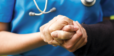 Patient and Provider Grasping Hands